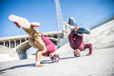 Break dancers performing tricks