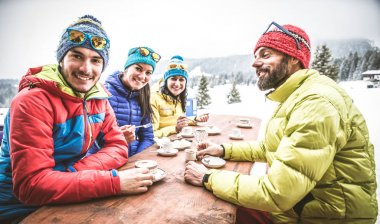 Snowboarders drinking coffee in restaurant