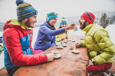 Snowboarders drinking coffee in restaurant