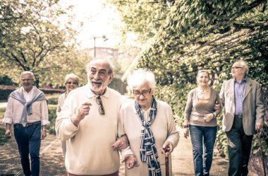 Smiling old people walking