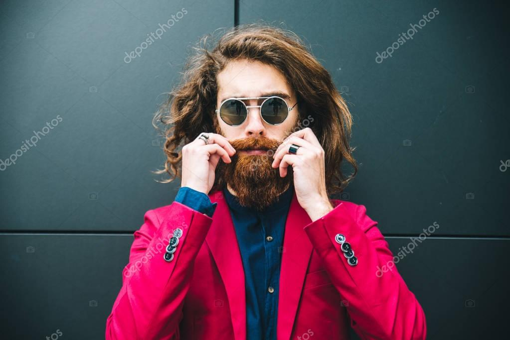 Hipster man in red suit