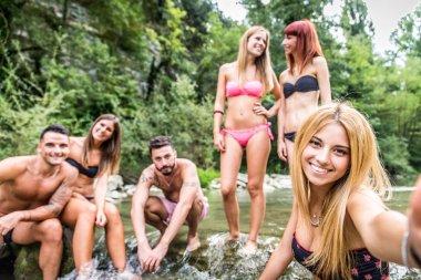 Friends having fun at river