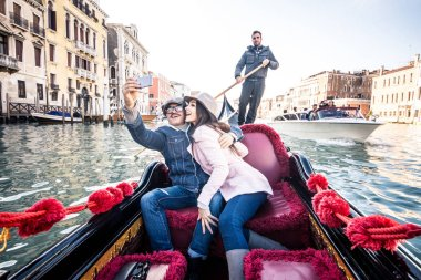 Couple of lovers in venetian gondola