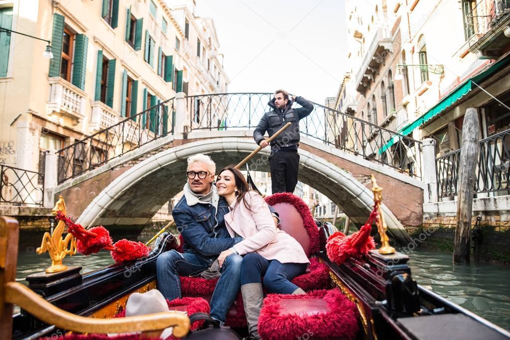 Couple of lovers in venetian gondola