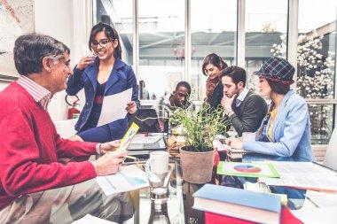 Creative team brainstorming in modern office