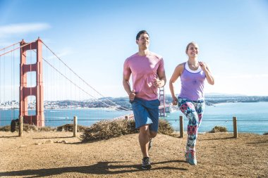 Couple running in San Francisco
