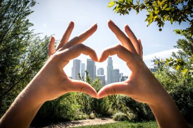 Los angeles downtown, artistic composition with woman drawing heart