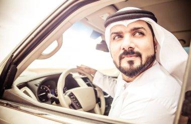 Arabic man in car
