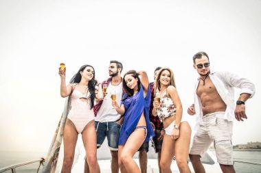 People celebrating on yacht