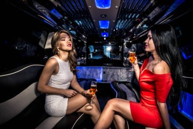 Girls partying in limousine