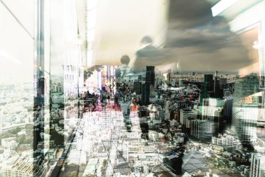 double exposure of tokyo city and people walking