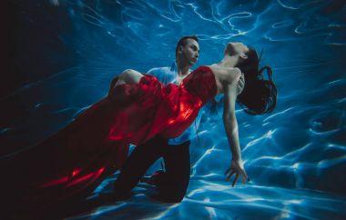 Couple dreamlike situation underwater