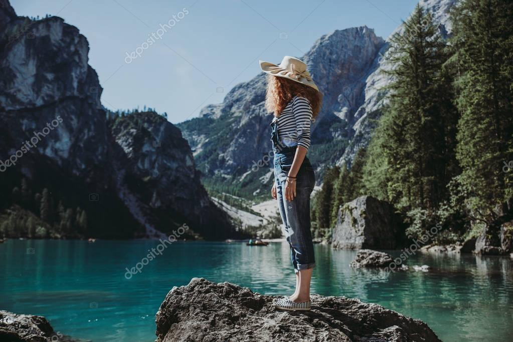 Woman looking at mountain landscape