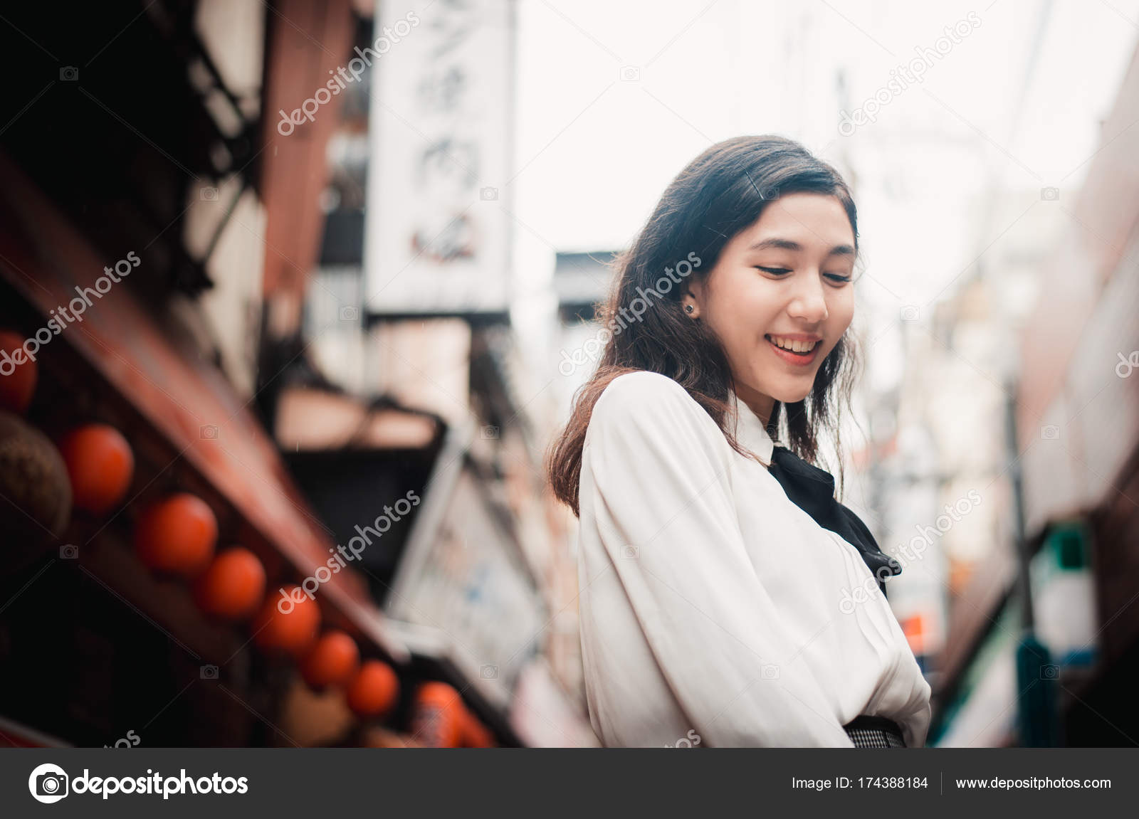beautiful japanese girl walking in tokyo. concept about teenager