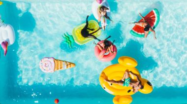 group of friends having fun in the swimming pool