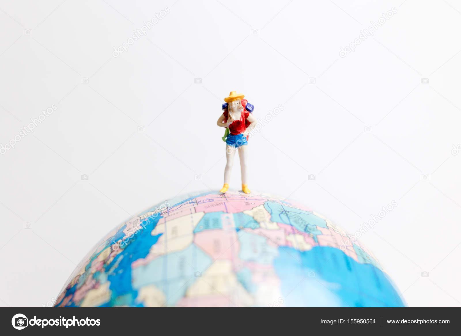 Miniature people figure standing on the globe world map stock miniature people figure standing on the globe world map stock photo gumiabroncs Choice Image