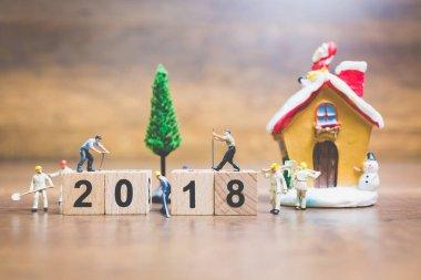 Miniature people : worker team building wooden block number 2018