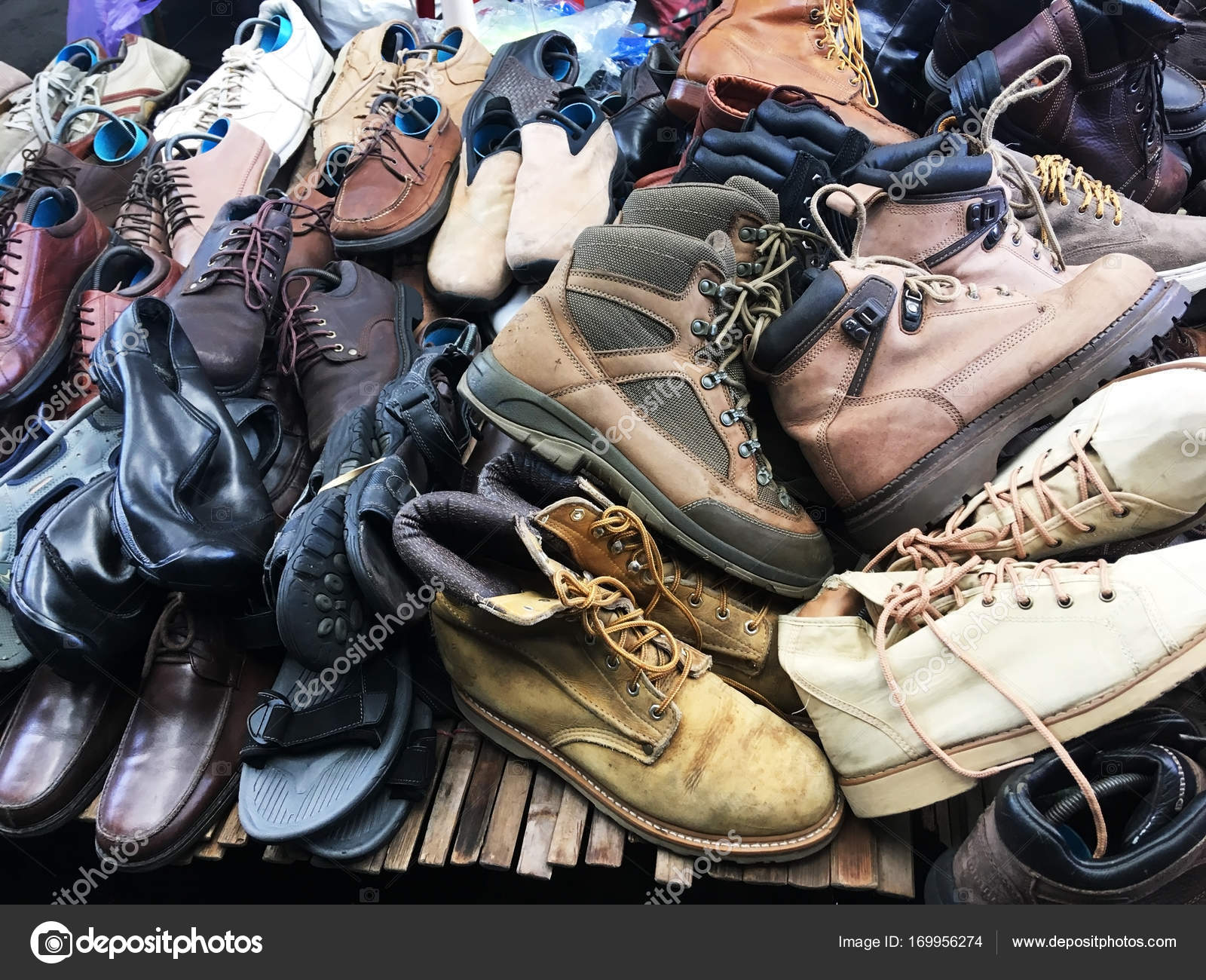 2c184ac06dc Pile of second hand shoes on shelf at weekend market. — Stock Photo ...