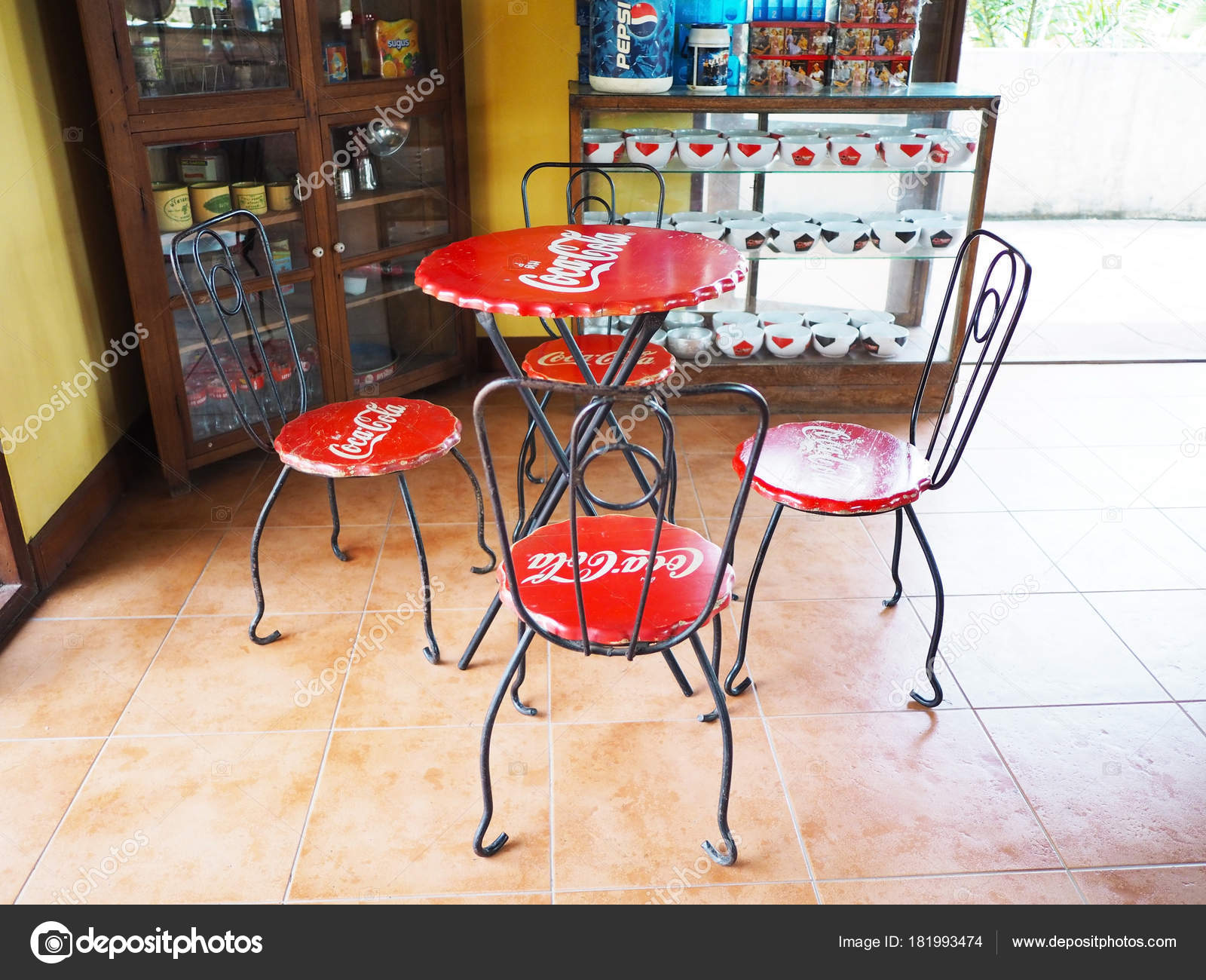 Set of red chairs and table with Coca Cola brand – Stock Editorial