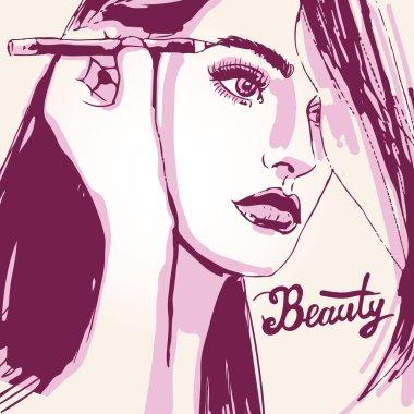 Woman visagist makeup artist paints on the face of his client.