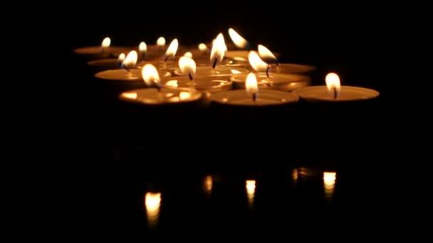 Group of tea candles burning. Close up