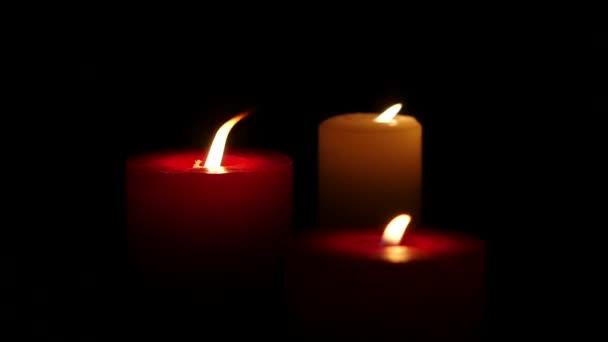 Burning candles black background, Close up. Slow motion