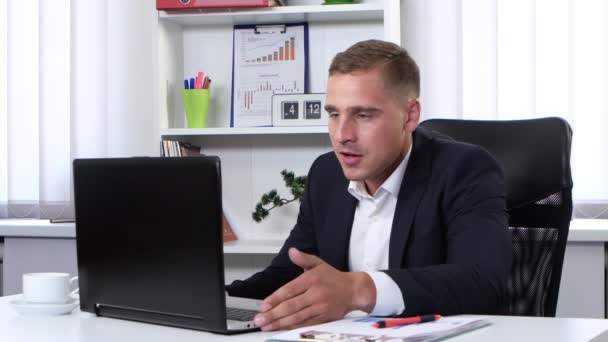 Businessman angry and nervous to talk on webcam