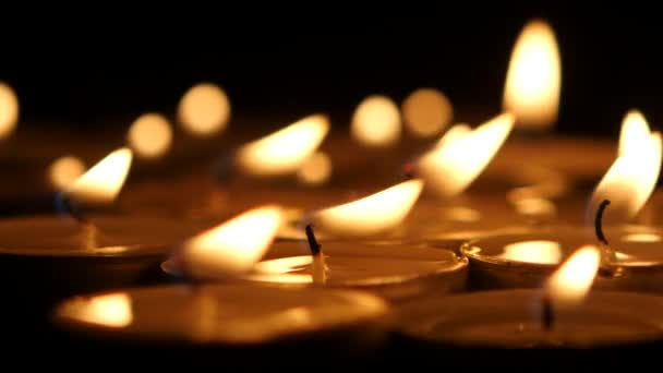 Brightly burning wax candles. Close up