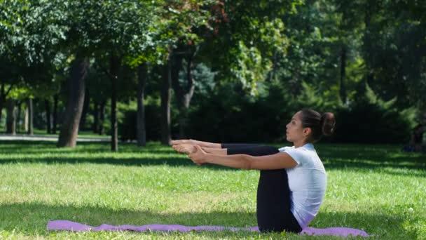 Girl is doing yoga in park