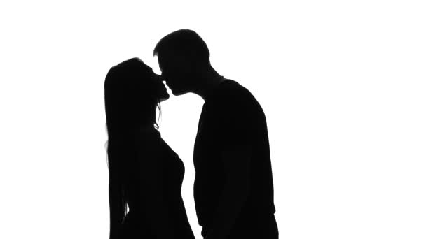 Silhouette of a loving couple. Silhouette. White