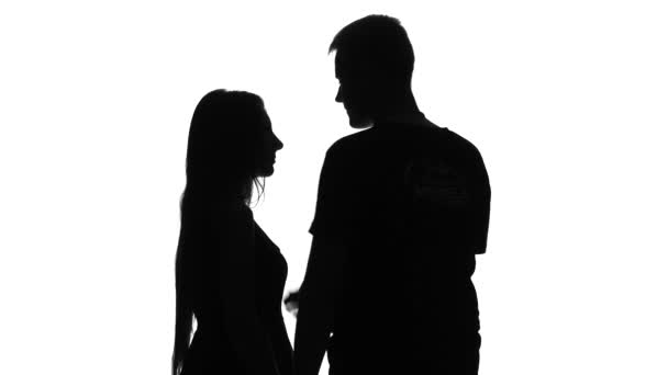 Romantic couple. Portrait of two people kissing. Silhouette. White