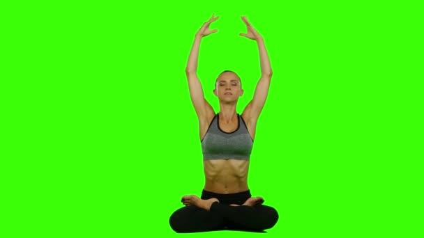 Žena, která dělá jóga meditace. Zelená obrazovka