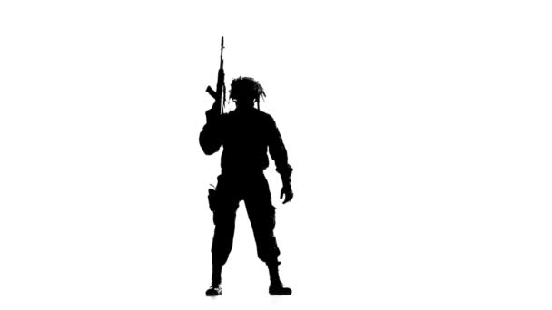 Soldier aimed and looking around. Silhouette