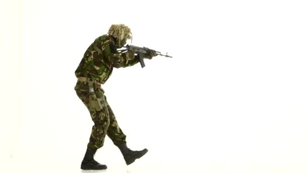 Soldier in camouflage clothing and armed. White backgraund