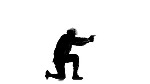 Man sent a weapon to the side. Silhouette