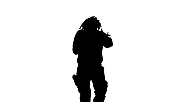 Soldier runs with a gun in his hand. Silhouette