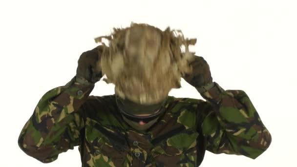 Soldier wears a helmet on his head. White backgraund
