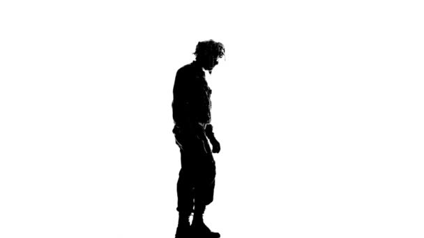 Soldier walking with a gun in his hand. Silhouette