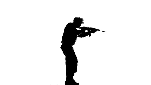 Soldier holding weapons in the hands of. Silhouette