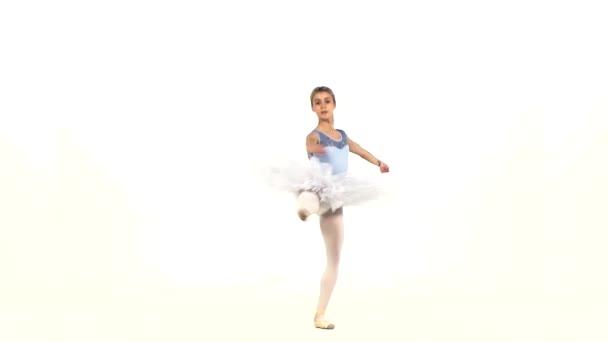 Portrait of the ballerina in ballet pose on white, slow motion