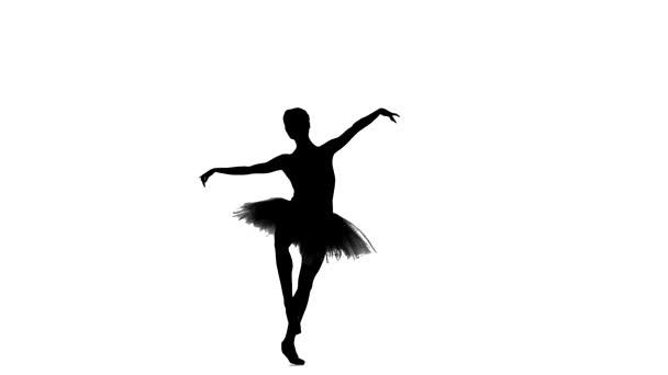 Ballerina im Tutu zeigt ihre Techniken, Silhouette, Zeitlupe