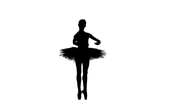 junge schöne Tänzerin posiert auf einem Studio, Silhouette, Zeitlupe