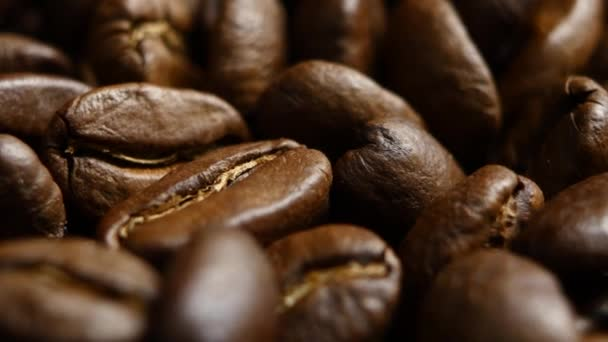 Rotation of aromatic roasted coffee beans. Close up. Rotating