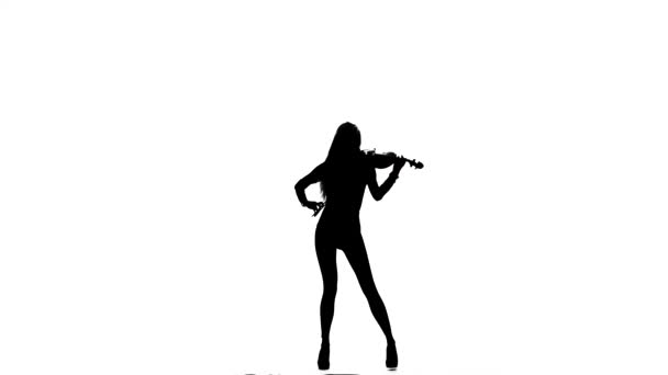 Woman playing chords the viola. Silhouette