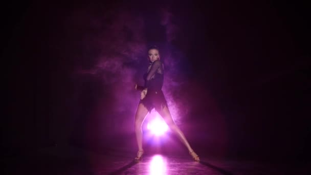 Dancer rumba in studio with purple lighting, a dark background