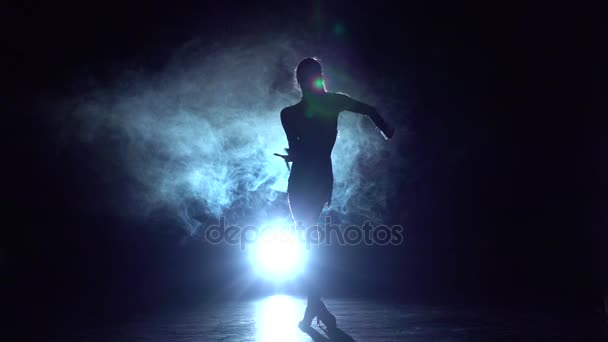 Dancer performs cha-cha-cha in the studio, silhouette. Slow motion