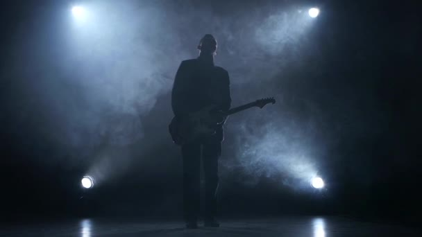 Electric guitar. The man plays for fun. Smoke. Slow motion