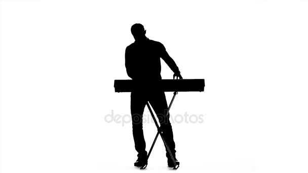 Silhouette of a man playing the piano. Slow motion — Stock ...