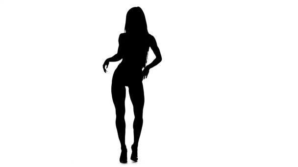 Silhouette bodybuilding girl posing on white background in black and white.