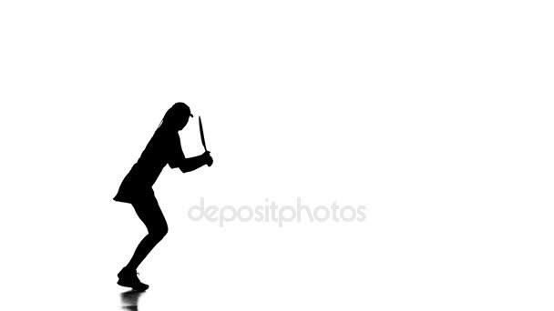 Dívka hraje tenis a skákání tenista. Bílé pozadí. silueta